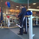 Burlington Mayor Miro Weinberger, right, and American Airlines Station Manager Irina Pacilo cut the ribbon to commemorate a new air route between Burlington International Airport and Charlotte, N.C. on Tuesday morning.