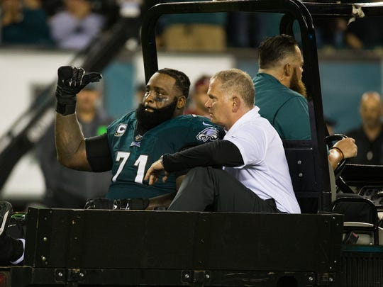 Eagles tackle Jason Peters gives a thumbs up to the fans as he is taken back to the locker room after sustaining an injury Monday night at Lincoln Financial Field.