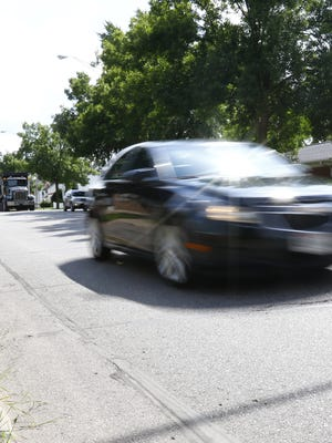 Traffic flows Tuesday afternoon on North Sixth Street in Wausau.