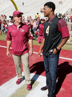 FSU head coach Jimbo Fisher talks with former quarterback Jameis Winston prior to the game between the Florida State Seminoles and the Louisville Cardinals at Doak Campbell Stadium.