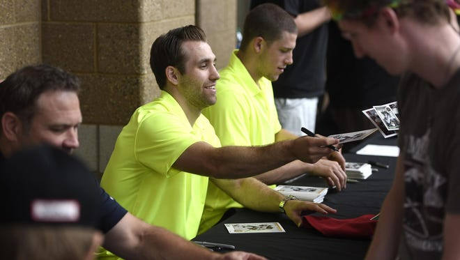 Minnesota Wild forwards Charlie Coyle and Jason Zucker sign autographs for fans Thursday during the Minnesota Wild Road Tour at the Herb Brooks National Hockey Center in St. Cloud.