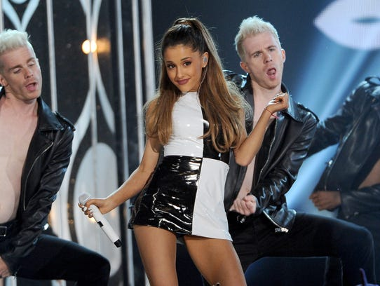 FILE - In this May 18, 2014 file photo, Ariana Grande performs at the Billboard Music Awards at the MGM Grand Garden Arena, in Las Vegas. MTV will reprise its former ?Total Request Live? countdown show for a day with breakthrough pop singer Ariana Grande. The network announced Wednesday, June 25, 2014, it will bring back the series on July 2.  (Photo by Chris Pizzello/Invision/AP, file)