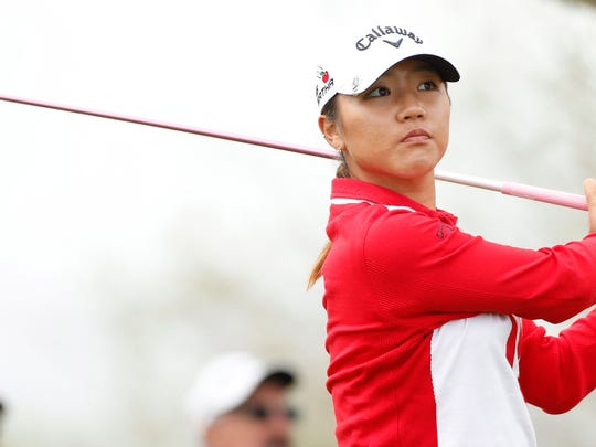 Lydia Ko tees off on the 11th hole during round one