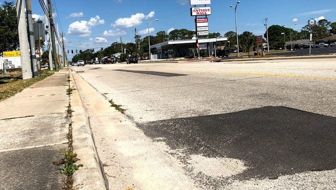 Hopkins Avenue in Titusville hasn't been fully upgraded in 30 years, and is now defined by its large chunks of filled potholes and uneven sidewalks.