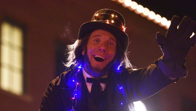 Sioux Falls mayoral candidate David Zokaites put a holiday spin on his Abraham Lincoln costume during the 2017 Parade of Lights in downtown Sioux Falls last week.