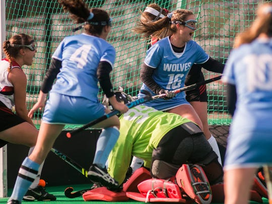 Center, South Burlington #16 Grace Hoehl celebrate after scoring during the DI field hockey championship played at UVM on Saturday, Nov. 4, 2017. South Burlington won 3-0, capturing their third straight championship.