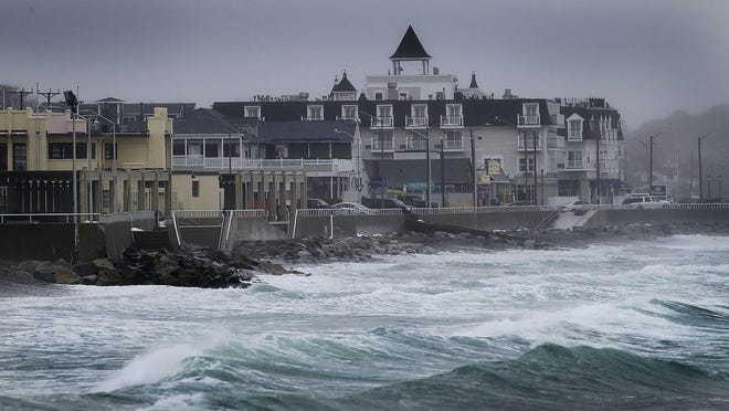 Rough water and waves splash on the seawall at Nantasket Beach, Hull as a storm moves through over the weekend on Sunday, Feb. 24. 2019. Greg Derr/ The Patriot Ledger