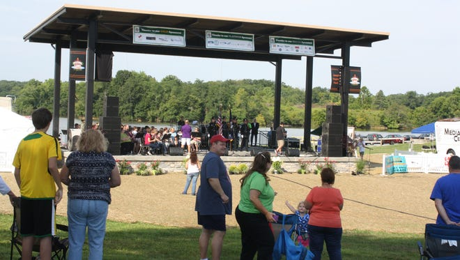 People gather around the new Joseph J. Stapleton Pavilion overlooking the 200-acre lake at A.J. Jolly Park during the Festival on the Lake Saturday, Aug. 16, 2014.