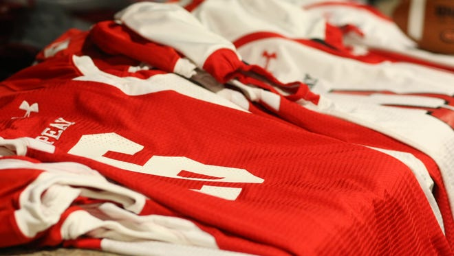 A collection of jerseys corresponding to the anticipated signees' high school numbers were stacked up for use during the mock draft selection process Austin Peay used to announce players on national signing day.
