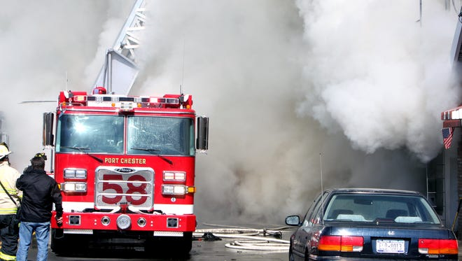 Port Chester firefighters battle a four-alarm fire that destroyed businesses and apartments on Midland Avenue in Port Chester on March 1, 2011.