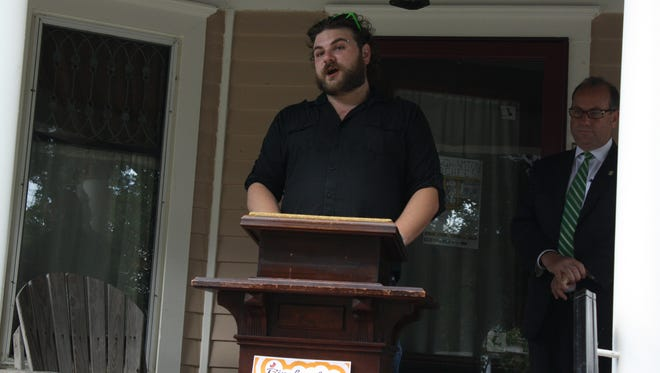 Porchfest organizer Chris Chris Bodnarczuk, 27, of Binghamton, announces the Porfchfest line-up during a press conference on 35 Chestnut St. in Binghamton.