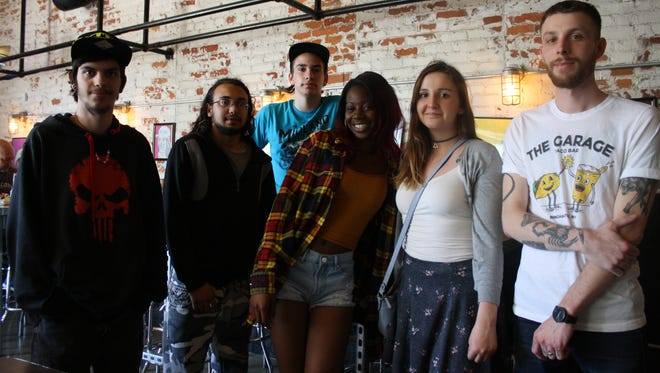 Students from Emily Rodgers' art class at BOCES East Learning Center Alternative High School have artwork hanging in The Garage in downtown Binghamton.