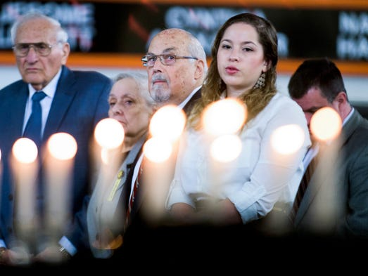 Candles are lighted during a Holocaust Education Program