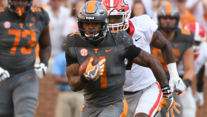 Tennessee Vols running back John Kelly (4) rushes against Georgia on Sept. 30, 2017. A three-star recruit, he is now trying his luck in the NFL.