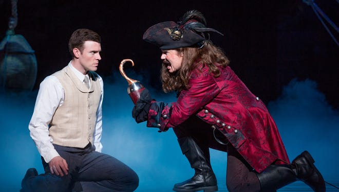 """Billy Harrigan Tighe (left) as J.M. Barrie and John Davidson as Captain Hook in the National Tour of """"Finding Neverland,"""" playing Nov. 7-19 at the Aronoff Center as part of the Broadway in Cincinnati series."""