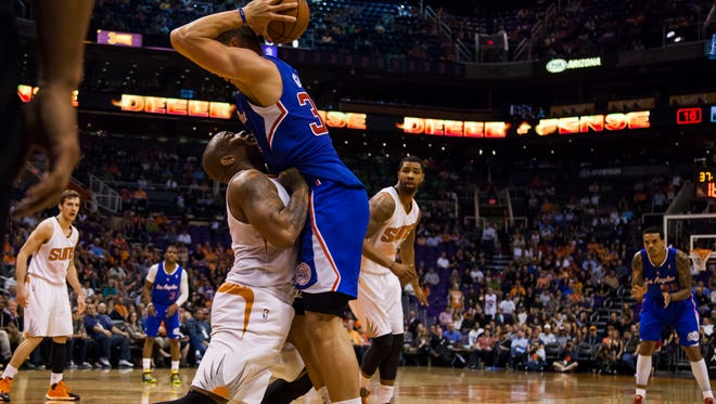 March 4, 2014 - Suns forward P.J Tucker runs into Blake Griffin during the game against the Clippers.