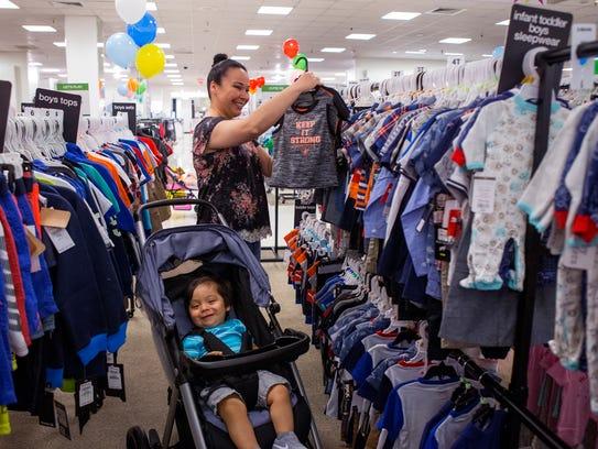 Lydia Lobo and her son, Luke Lobo, 16 months, shop