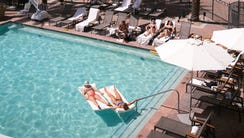 Guests enjoy the main pool at the Fairmont Scottsdale