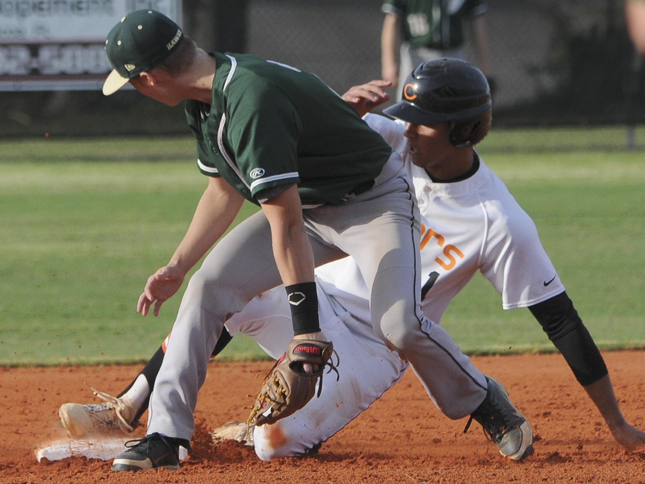 Cocoa's Zach Armour safely makes it to second before the tag by Brody Legate of Viera during Wednesday's game.