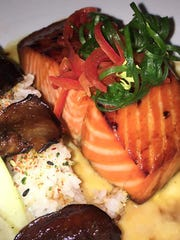 Tea-smoked king salmon is an entree at The Oyster Society in Marco Walk Plaza on Marco Island.