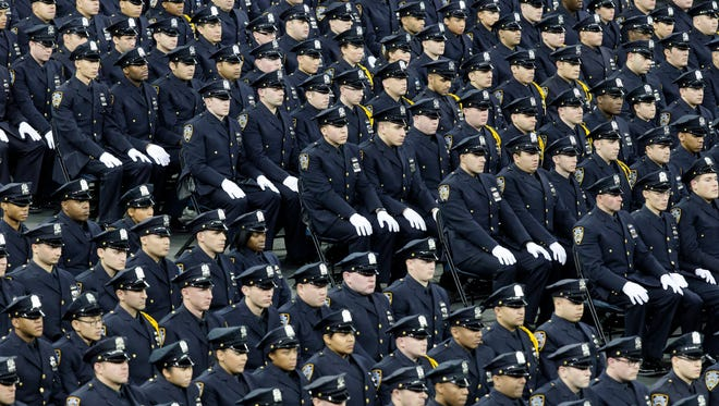 New recruits attend their New York Police Police Academy graduation ceremony, Dec. 29, 2014, at Madison Square Garden in New York.