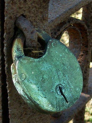 A vintage lock on a gate near the house hinted at the treasures to be found in a room of mysteries.