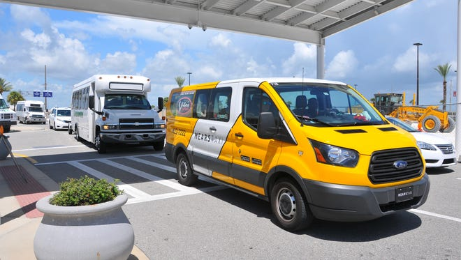 Buses, taxis and park-and ride vans drop off and pick up passengers at Port Canaveral Cruise Terminal 6.