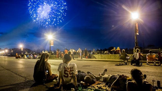 People gather along Wheeling Avenue to see a past Fourth of July fireworks show in Muncie.