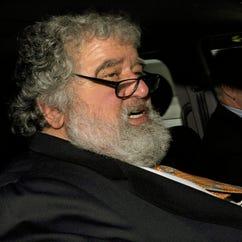 Chuck Blazer is shown leaving the FIFA headquarters