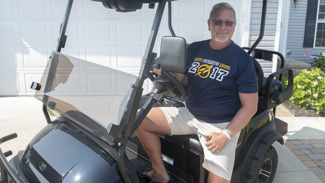 Chuck Cooley with his golf cart. Lisa Scalfaro, Record-Courier