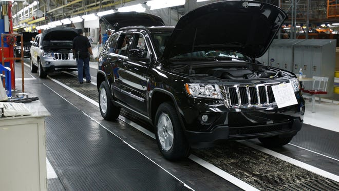A new Jeep comes down the line at Fiat Chrysler plant in a 2010 file photo