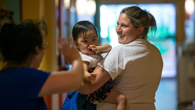 Registered Nurse Megan Kuhn takes a patient to the recreational play therapy room at Exceptional Care for Children.