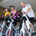 From left YMCA staffer Ashley Hodges of Chatham and Anne DeSalvo of Madison and Kevin Catlin of Madison participate in the Madison Area YMCA and St. Baldrick's Foundation three-hour Spinathon on March 29, 2015 with all proceeds being split between St. Baldrick's and the Y's annual LIVESTRONG and the YMCA fund.
