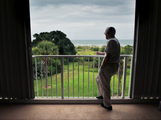 Jack looks off the balcony of his Cape Canaveral beachfront condo as he reminisces about his wife.
