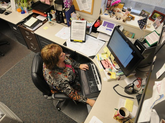 Brown County Child Protection Services Intake Access social worker Mina Teske works inside the Sophie Beaumont Building in Green Bay. Teske said her job is usually the initial point of contact in child abuse or neglect cases.