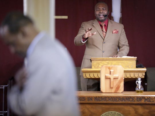 Senior Pastor A.T. Dupree Jr. leads the congregation in prayer as Family First Ministries, Church of God In Christ, one of several churches to make their home in downtown Appleton, holds a service, Sunday, December 20, 2015.