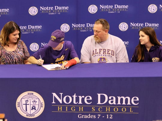 Notre Dame senior Gavin Harrington signs to play soccer at Alfred University during a ceremony May 17.