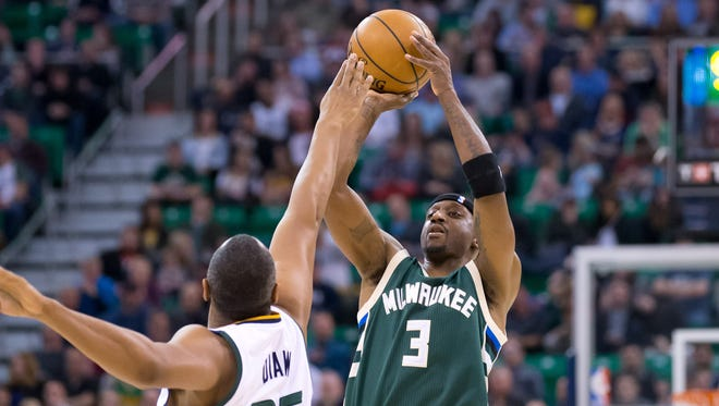 Milwaukee Bucks guard Jason Terry (3) shoots the ball against Utah Jazz center Boris Diaw.