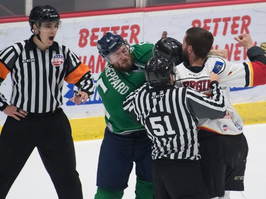 Officials attempt to pull apart Everblades' Derek Sheppard and Thunder's Mike Bergin as they squabble during Game 5 of the Eastern Conference Finals at Cool Insuring Arena in Glens Falls, N.Y., on Saturday, May 19, 2018.