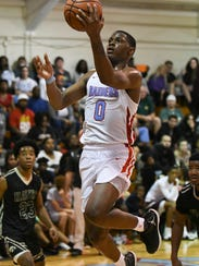 Elijah Weaver of Rockledge shoots during a game against Viera.