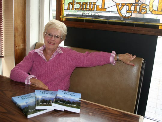 Kris Lockard, author of a new novel set in the Mid-Valley and elsewhere around Oregon, relaxes at Holding Court on Tuesday.