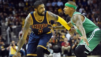 Cleveland Cavaliers guard Kyrie Irving (2) dribbles against Boston Celtics guard Isaiah Thomas (4) during the first quarter at Quicken Loans Arena.