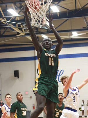 Gallatin's Zook Kuth dunks on White House on Tuesday. Gallatin won 62-55.