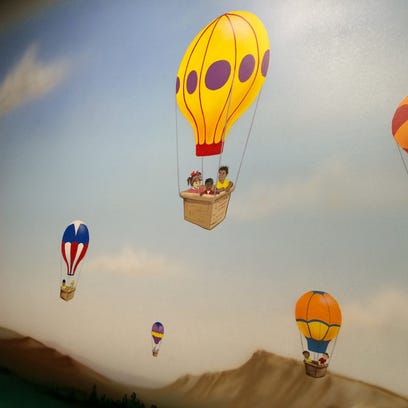 A mural in one of the six-room wings, which has a hot-air-balloon
