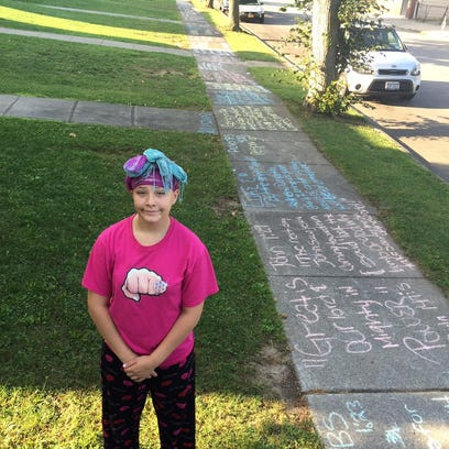 Chelsea Pike, 14, covered the sidewalk of an entire