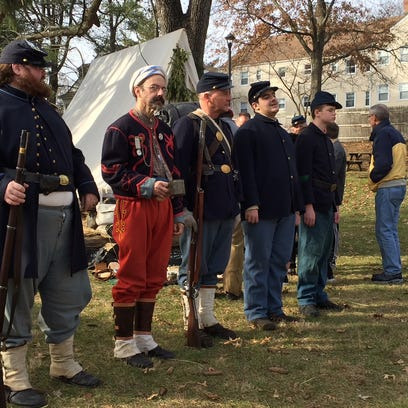 Soldiers from the 7th NJ Regiment line up for Roll
