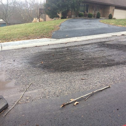 Cold patch fills in what was a significant-sized pothole