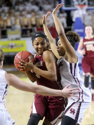 Riverdale's Anastasia Hayes (03) pushes around Oak Ridge's (22) Caelyn Thompson during the State Tournament Championship on Saturday March 12, 2016, at MTSU.