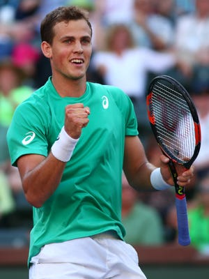 Vasek Pospisil of Canada pumps his fist Thursday, March 17, 2016 after he and partner American Jack Sock won a men's doubles quarterfinal match against Philipp Kohlschreiber and Dominic Thiem during the BNP Paribas Open in Indian Wells, Calif. Sock and Pospisil won in straight sets 7-5 and 6-3.