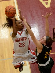 Susquehannock's Jaden Walker leaps over Archbishop Wood defender Katie May for a shot at the hoop during the PIAA Class 5-A semifinal girls' basketball game, Tuesday, March 21, 2017. John A. Pavoncello photo